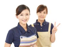 Smiling women in apron. Portrait of Asian women in apron stock images