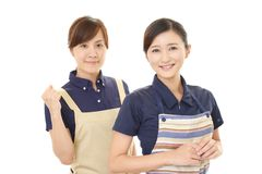 Smiling women in apron. Portrait of Asian women in apron stock photography