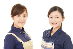Smiling women in apron. Portrait of Asian women in apron royalty free stock images