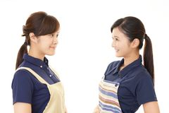 Smiling women in apron. Portrait of Asian women in apron stock photo