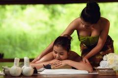 Portrait of Asian woman is relaxing in spa massage, Thai massage. Portrait of Asian women is relaxing in spa massage, Thai massage stock photos