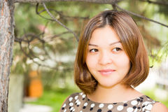 Portrait of the asian young beautiful smiling woman outdoors royalty free stock image