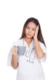 Portrait of Asian young female doctor got headache Royalty Free Stock Photo
