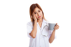 Portrait of Asian young female doctor got headache Stock Photo
