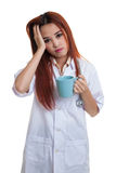 Portrait of Asian young female doctor got headache. Stock Images