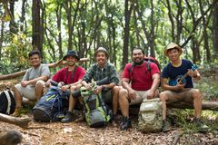 Young friends hiking together. Portrait of asian young friends hiking together in the forest Royalty Free Stock Photos