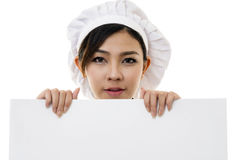 Portrait of Asian young woman chef  on white. Background Royalty Free Stock Images