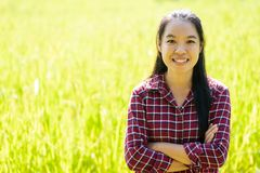 Asian young woman farmer standing in organic rice field stock photos