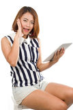 Portrait of Asian young woman holding tablet computer Royalty Free Stock Photos