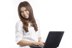 Portrait of Asian young woman with Laptop computer Stock Image