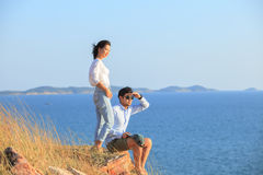 Portrait of asian younger man and woman relaxing vacation at sea Royalty Free Stock Photo