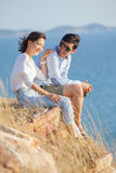 Portrait of asian younger man and woman relaxing vacation at sea Royalty Free Stock Photography