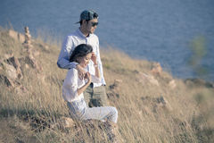 Portrait of asian younger man and woman relaxing vacation at sea Royalty Free Stock Image