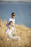 Portrait of asian younger man and woman relaxing vacation at sea Stock Images
