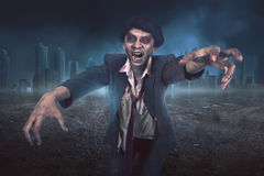 Portrait of asian zombie man with suit with wounded face stock photography