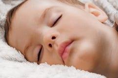 Portrait of asleep child. On white fluffy plaid Royalty Free Stock Photo