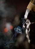Portrait of the Asmat smokes in twilight Royalty Free Stock Photo