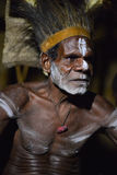 The Portrait Asmat warrior with a traditional painting and coloring on a face. Stock Images