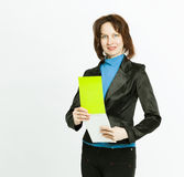 Portrait of an assistant woman with papers on white background Royalty Free Stock Photos