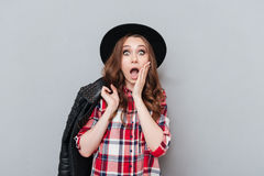 Portrait of an astonished amazed girl in plaid shirt Royalty Free Stock Photos