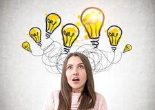 Portrait of an astonished woman in pink, light bulbs royalty free stock images