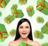 A portrait of astonishing woman who imagines green gift boxes. Royalty Free Stock Photo