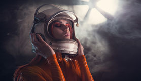 Portrait of astronaut girl in helmet Stock Photos