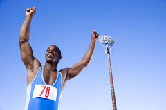 Portrait of an athlete with arm raised Royalty Free Stock Photography