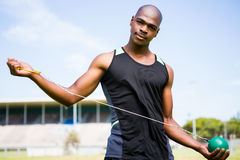 Portrait of athlete holding hammer throw. In stadium stock photo