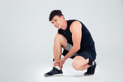Portrait of athlete man suffering from pain in leg Stock Photos