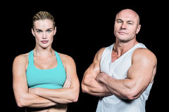 Portrait of athlete man and woman with arms crossed Stock Photography