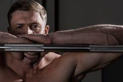 Portrait of Athlete muscular bodybuilder with bar Stock Photos