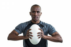 Portrait of athlete pressing rugby ball Royalty Free Stock Images