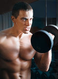 Portrait of an athlete who lifts a dumbbell Stock Image