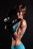Portrait of an athletic boxer woman Royalty Free Stock Images