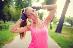 Portrait of an athletic girl working out and stretching in park Royalty Free Stock Photo