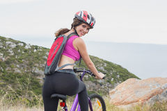 Portrait of athletic woman mountain biking Stock Photos