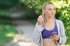 Portrait of athletic young woman resting after jogging. Stock Images