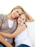 Portrait of an attentive mother and her daughter. Sitting on the sofa Royalty Free Stock Photography