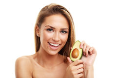 Portrait of attractive adult woman with avocado isolated over white background Royalty Free Stock Photo