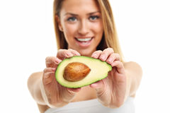 Portrait of attractive adult woman with avocado isolated over white background Stock Photo