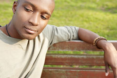 Thoughtful man on bench. Stock Image