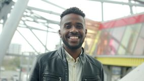Portrait of attractive African American man smiling looking at camera outdoors stock video footage
