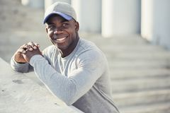 Handsome and confident. Outdoor portrait of smiling young african man Stock Photography