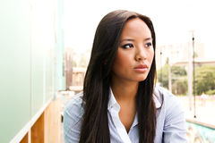 Portrait of an attractive asian business woman. Day dreaming stock photo