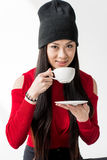 Portrait of attractive asian woman holding tea cup isolated. On grey Stock Photography