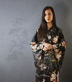 Portrait of attractive Asian woman in kimono Stock Image