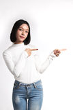 A portrait of attractive asian woman pointing at copysp Royalty Free Stock Images