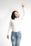 A portrait of attractive asian woman pointing at copyspace Stock Photography
