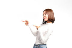 A portrait of attractive asian woman pointing at copyspace Royalty Free Stock Photos